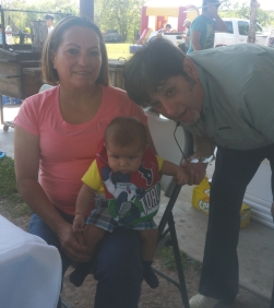 Pebble with his loving grandparents on his first Easter celebration.