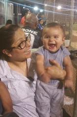 At the ballpark, supporting mommy and daddy with auntie Yesenia.