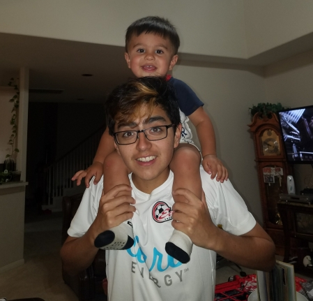 Pebble on his oldest cousin's shoulders.