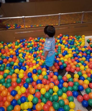 He loved this day! Surrounded by balls!